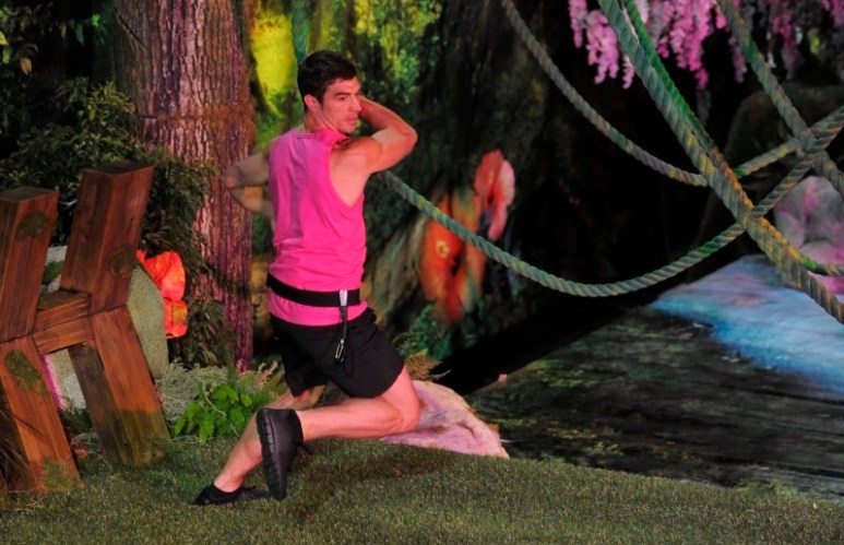 Cody swinging from vines in the Big Brother house