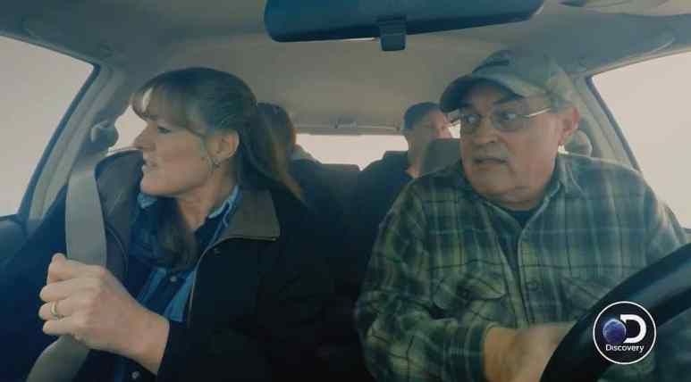 The Hanson family in a car with smoke around them on Homestead Rescue