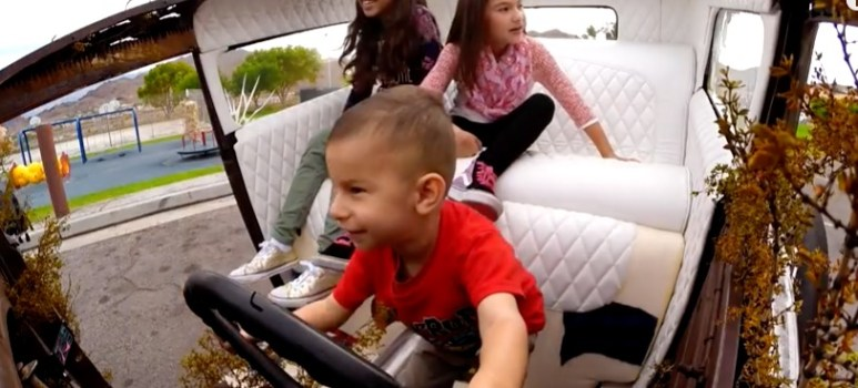 Joe's son and daughters check out the new wheels