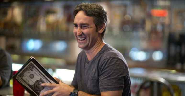 Mike Wolfe laughing in a scene from American Pickers