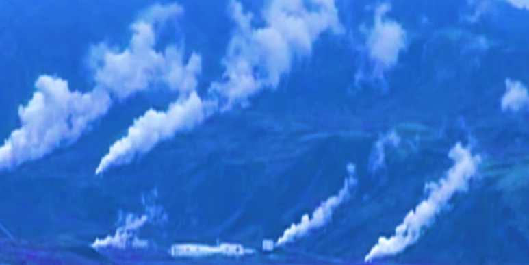 Color enhanced photo of geothermal steam rising in Iceland
