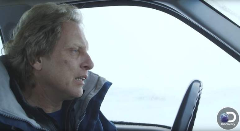 Sig Hansen looking pale while driving a car on Deadliest Catch