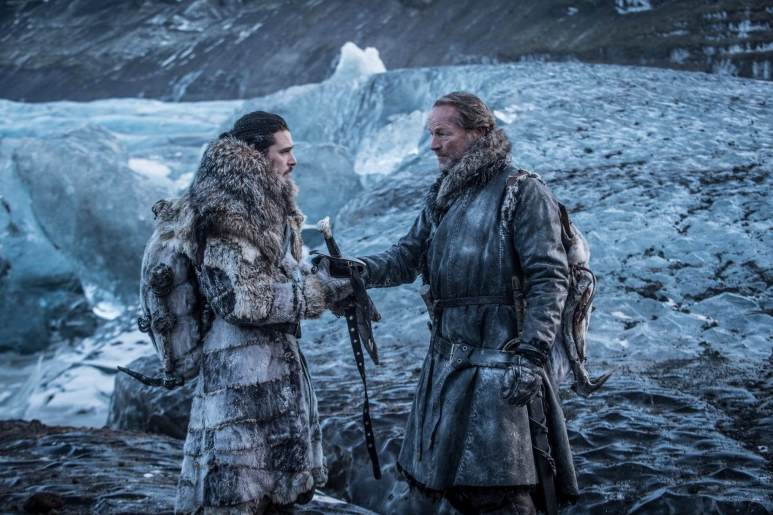 Snow giving Mormont his family sword, rebuffed as Jorah says he no longer has claim to it