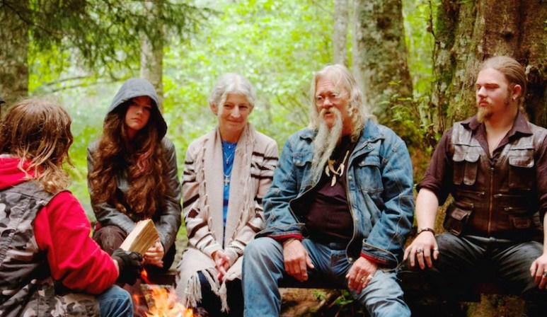 The Brown family sitting around a camp fire on Alaskan Bush People