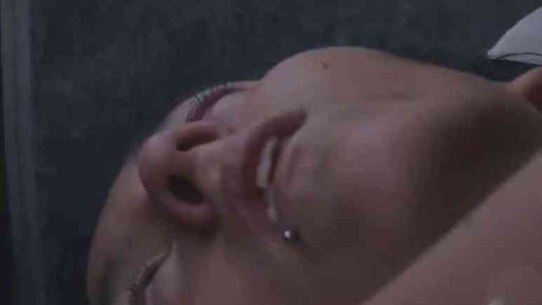 Sam's face closeup as she lies unconcious
