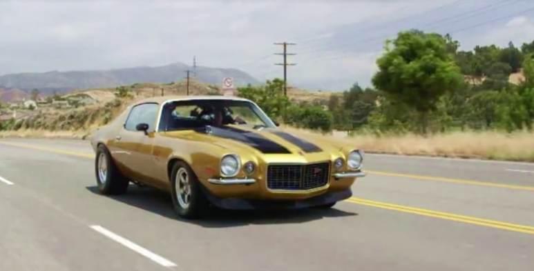 Gold 1971 Camaro on the road in desert