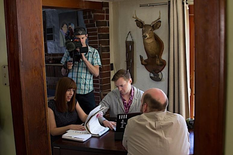 Amy Bruni and Adam Berry talk with homeowner Jason Brown.