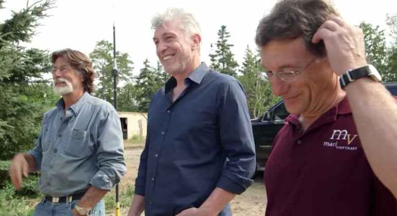 Randall Sullivan standing with Rick and Marty Lagina on The Curse of Oak Island