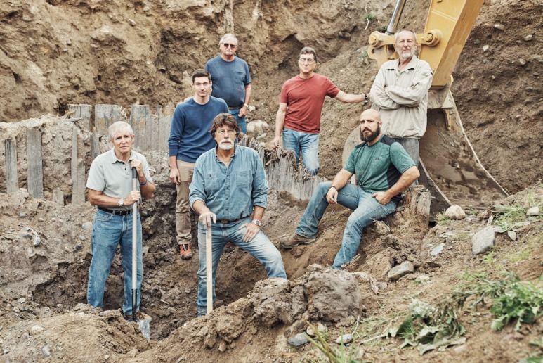 The Curse of Oak Island team inside the dig hole