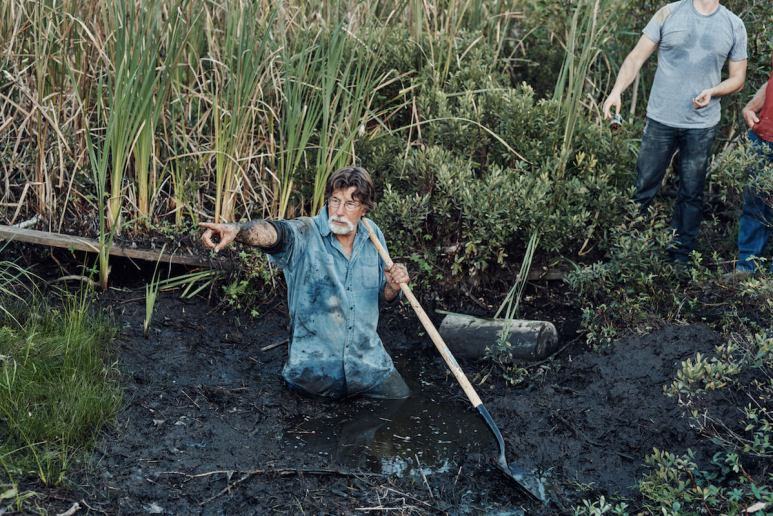 Rick points from inside the swamp on on The Curse of Oak Island Season 5