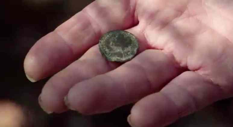 Old coin on a hand