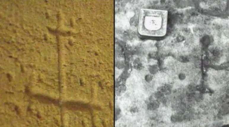Carvings of a cross in Domme prison and the HO stone