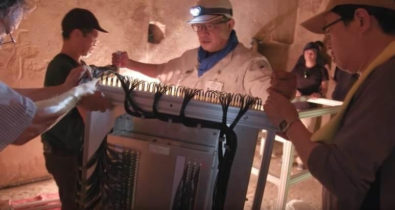Team members setting up kit inside the pyramid