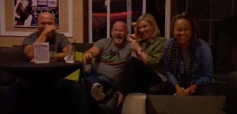 People in bar laughing