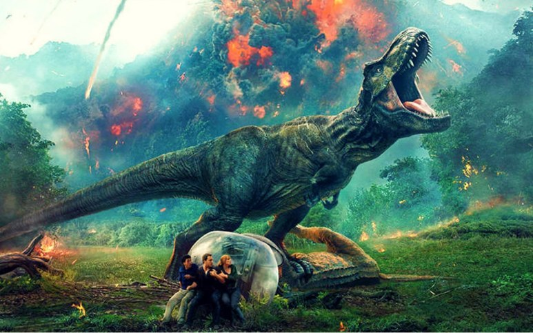 A t-rex and members of the cast in a promotional photo for Jurassic World: Fallen Kingdom