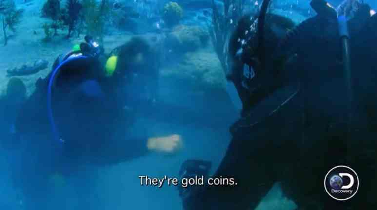 After the excitement of the gold coins find as Darrell and Eric fist bump underwater.