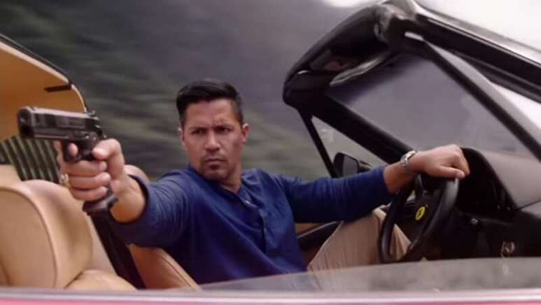 Jay Hernandez is behind the wheel as he tries to shoot a criminal on the new Magnum PI