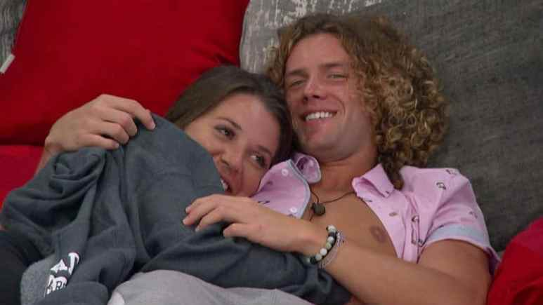 Tyler and Angela laying in the Head of Household bed
