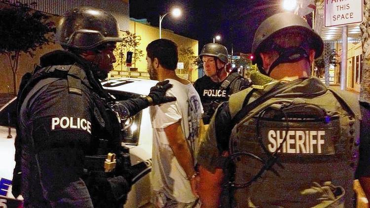 Adam Matos being arrested for murder