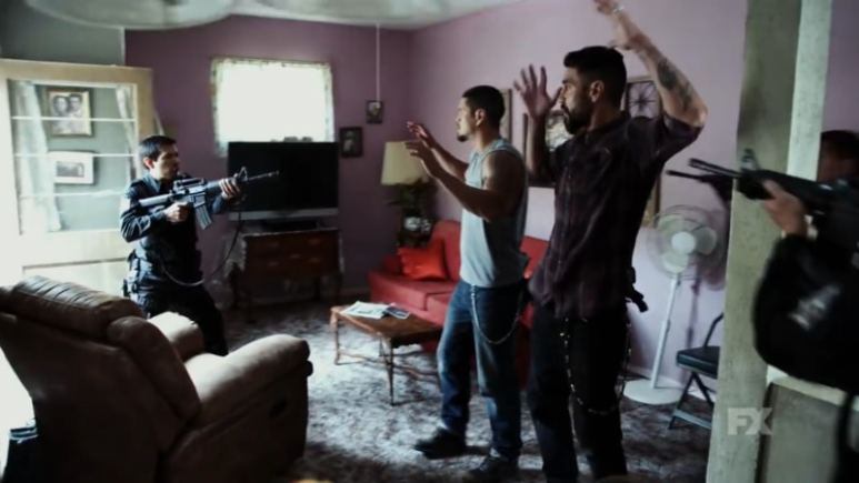 Still Image: Mayans M.C. Season 1 Ep. 5 Uch/Opossum Preview. EZ and Angel are held at gunpoint by the police in a surprise raid. Pic Credit: FX