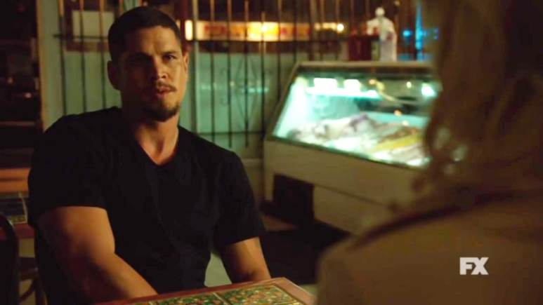 Still image from Mayans M.C. official trailer. Emily meets with EZ in his father's butcher shop to ask a troubling question.