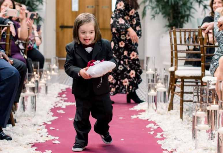 Rocco is beaming as he is assigned to be the ring bearer at Cristina and Angel's wedding