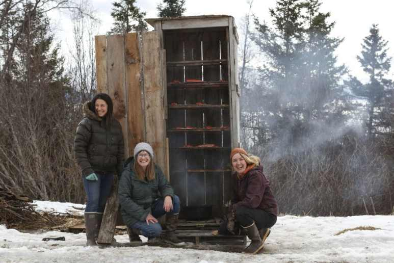 Charlotte and Eve Kilcher along with Tela pose are smoking salmon. Pic credit: Discovery
