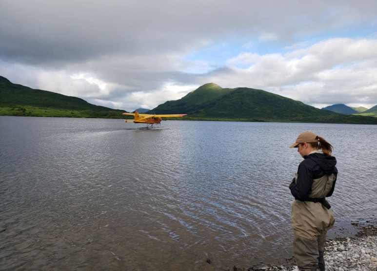 One of the service workers, Lisa Hupp watching a plane land on water. Pic credit: Animal Planet