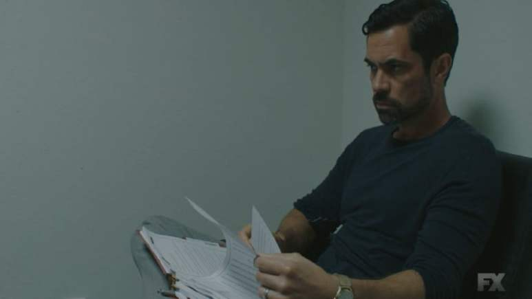Still Image: Mayans M.C. Rata/Ch'o. Miguel remembers his deal with Adelita and signs Potter's deal so his family can be released. Pic Credit: FX
