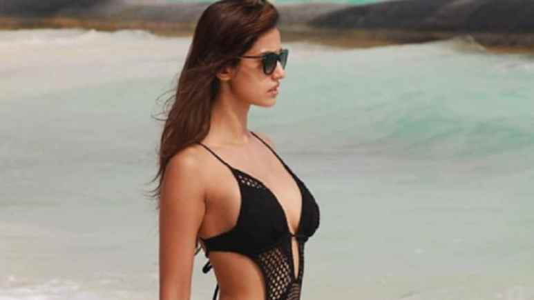 Disha Patani in black swimsuit at the beach