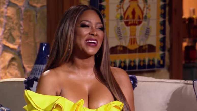 Kenya Moore dressed in yellow at the Season 10 RHOA reunion