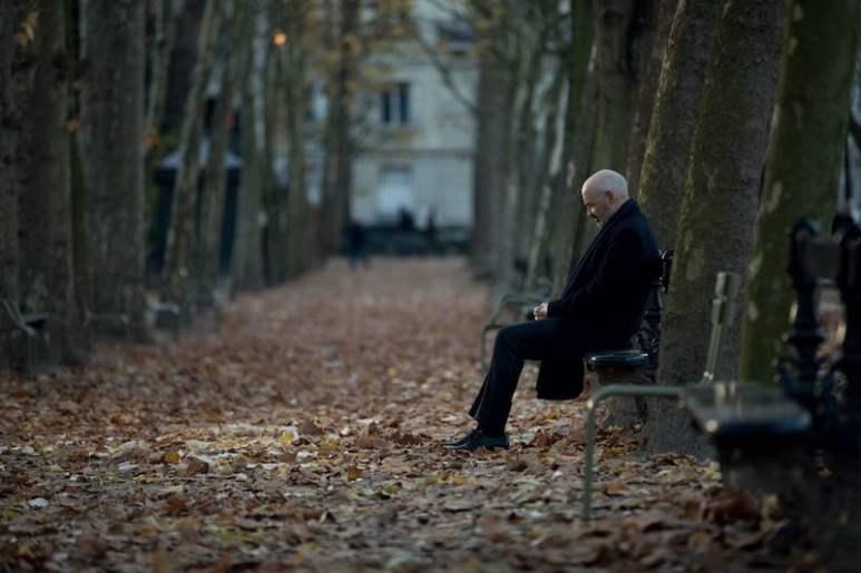 Tom sits alone