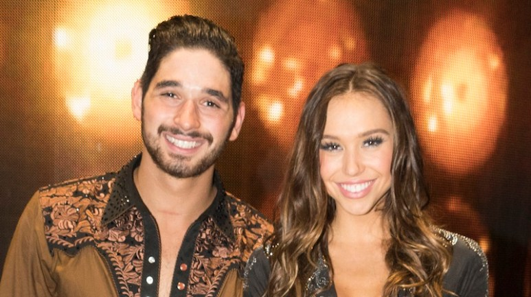 Alan Bersten and Alexis Ren posing backstage on Dancing with the Stars