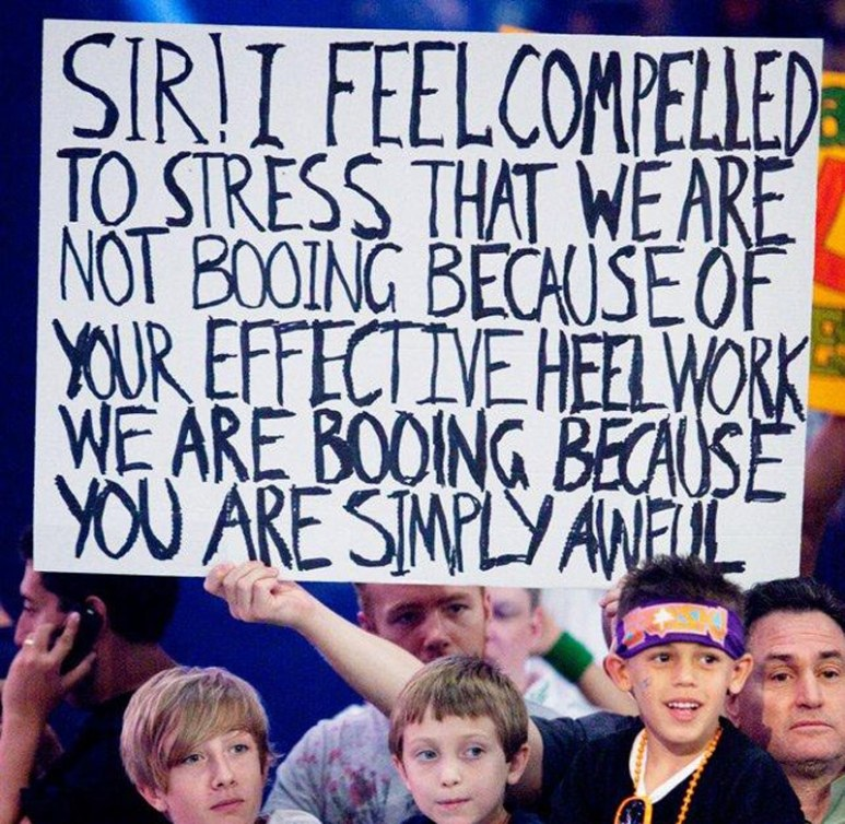 WWE fan holds up a sign