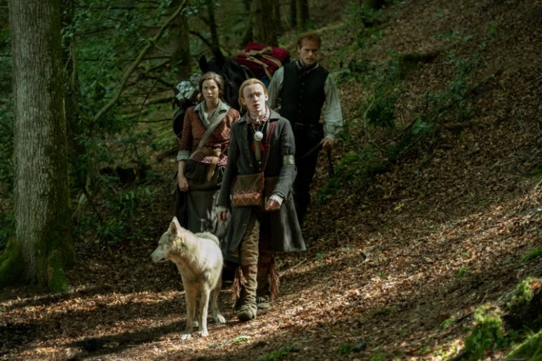Young Ian with Claire and Jamie in the woods on Outlander