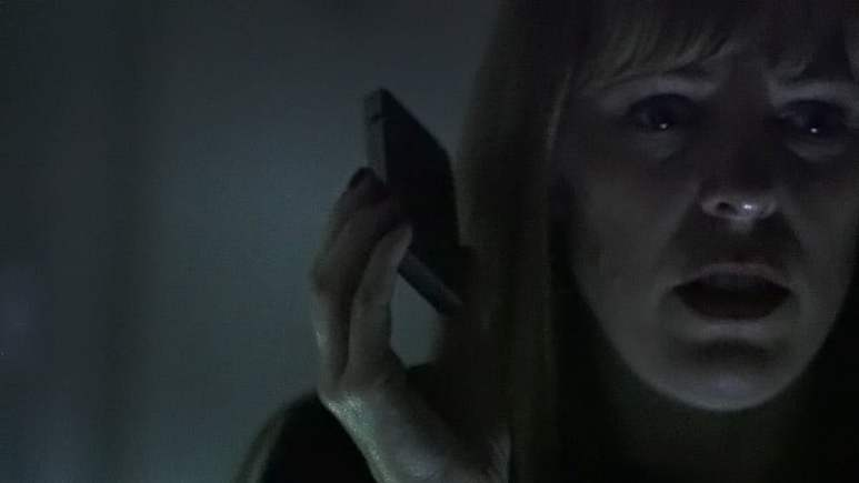 Amy Bruni listening for an EVP on Kindred SPirits