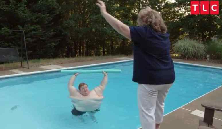 Casey works out in the pool while his mother instructs him on Family by the Ton