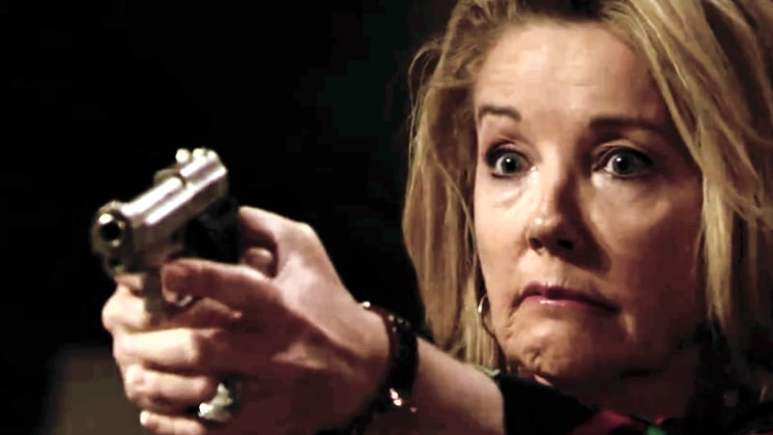 Nikki points her gun just before firing on The Young and the Restless