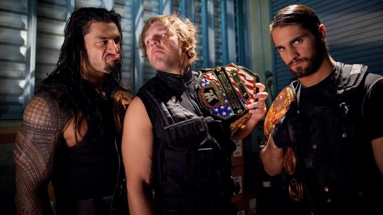 Seth Rollins and the Shield pose together with championship belts