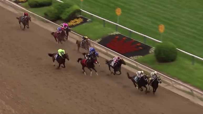horses race at preakness stakes in baltimore