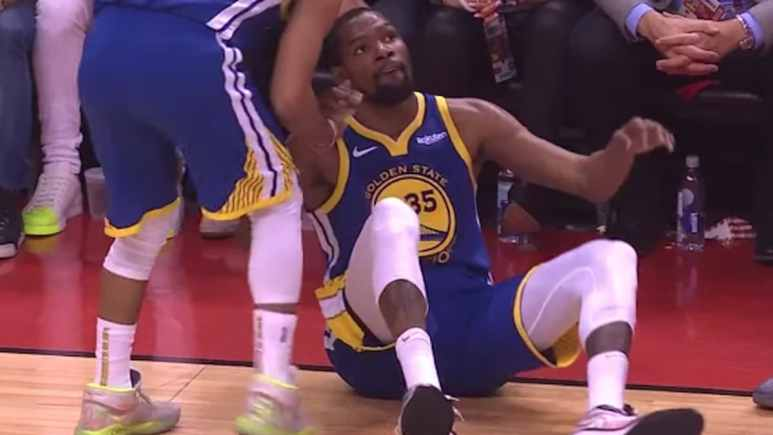 warriors teammates help kevin durant up after injury in NBA Finals