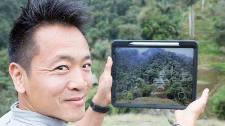 Here in Ciudad Perdida, Colombia, Albert Lin uses his tablet to reveal the wooden huts which would have covered each stone terrace of Ciudad Perdida at the time of the Tairona. Pic credit: NGC/Blakeway Productions