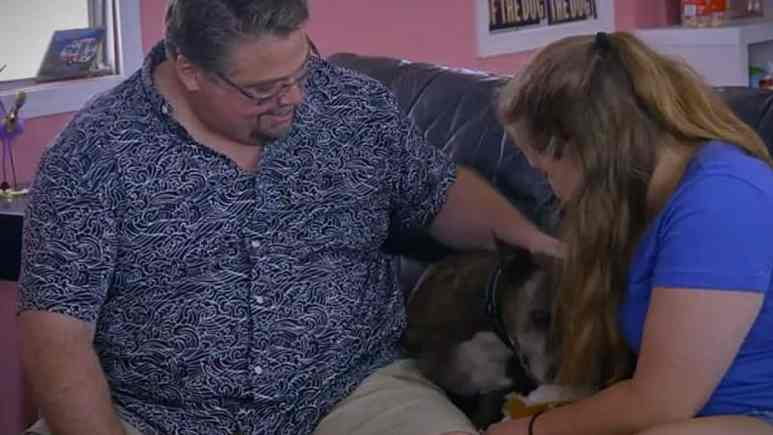 Boise family Michael and Katie meet Coco who army crawled to them. Pic credit: Animal Planet