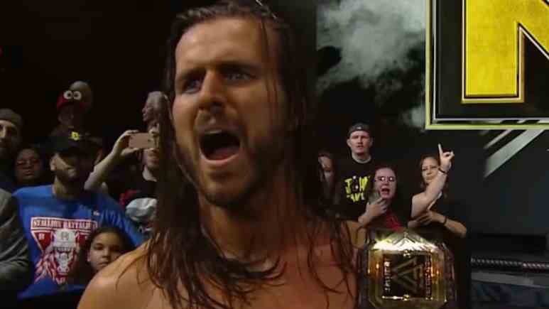 wwe nxt champion adam cole with belt after match