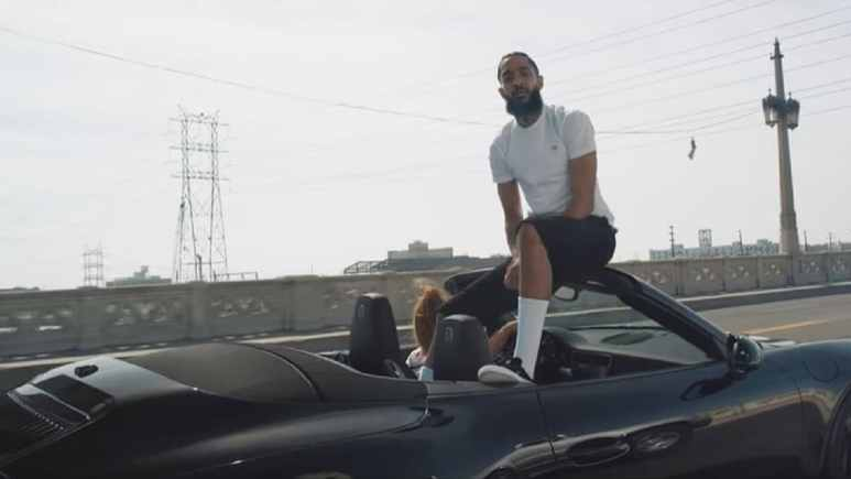 Rapper Nipsey Hussle performs in a music video
