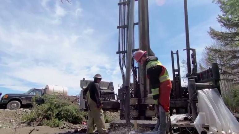 The team extracting core samples