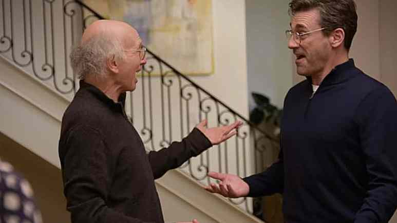Jon Hamm is a guest star on Curb Your Enthusiasm with star Larry David (L). Pic credit: Screencap/HBO