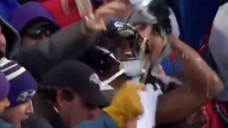 marcus peter drinking beer with fans during ravens bills game