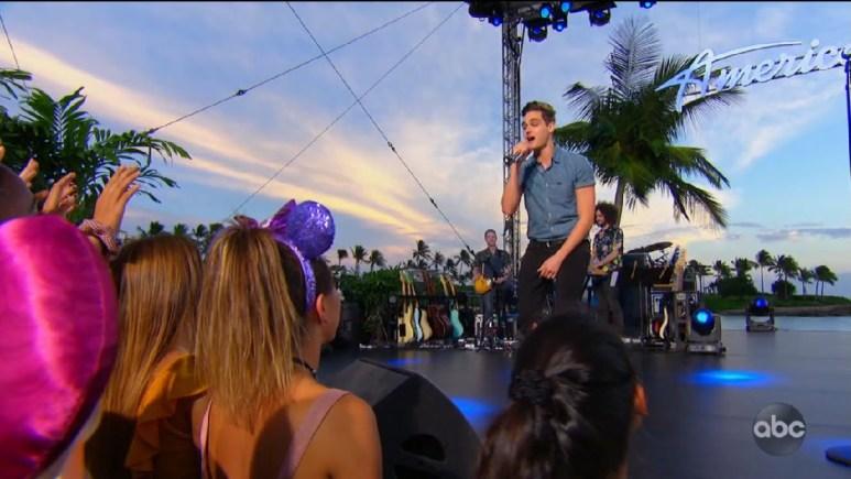 Nick Merico singing onstage