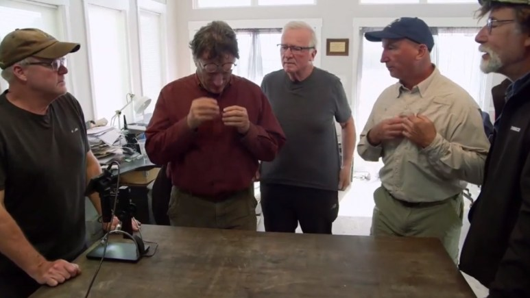 Oak Island team examine a new artifact
